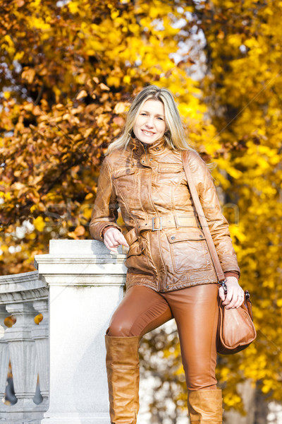 woman standing in autumnal park, Vienna, Austria Stock photo © phbcz