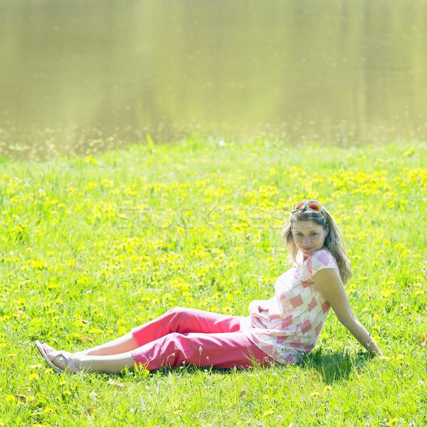 pregnat woman on meadow Stock photo © phbcz