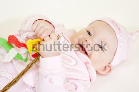 lying down baby girl holding a willow stick (Czech Easter) Stock photo © phbcz