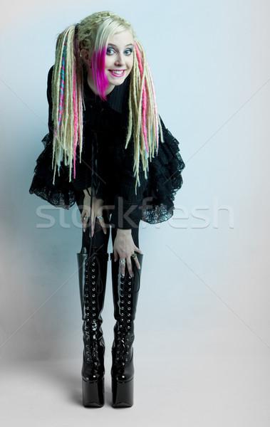 Fiatal nő visel extravagáns ruházat csizma csizma Stock fotó © phbcz
