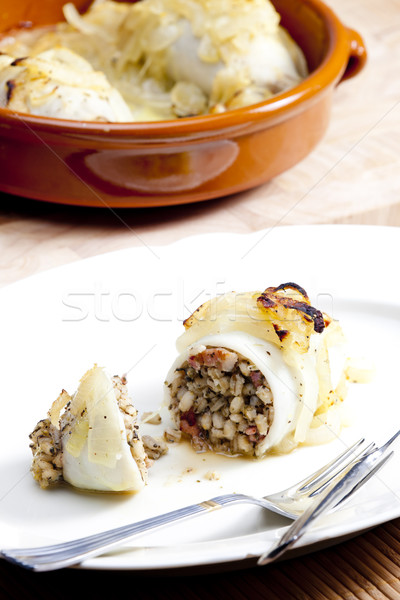 sepia filled with pearl barley baked with onion Stock photo © phbcz