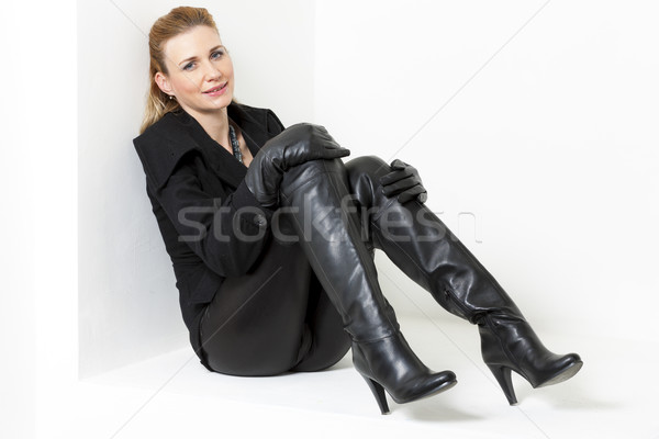 sitting woman wearing black clothes and boots Stock photo © phbcz