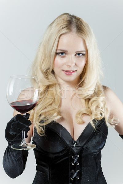 portrait of young woman with a glass of red wine Stock photo © phbcz