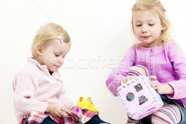 Játszik kettő kislányok gyermek pihen rózsaszín Stock fotó © phbcz