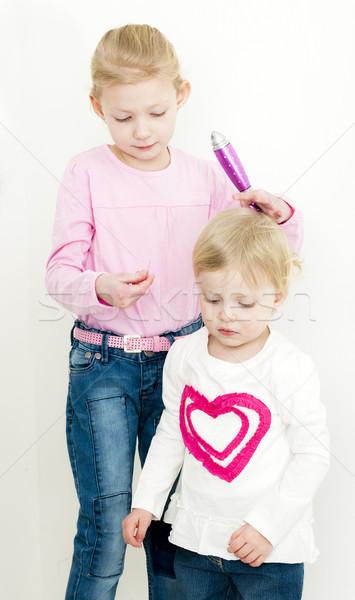 portrait of combing little girls Stock photo © phbcz