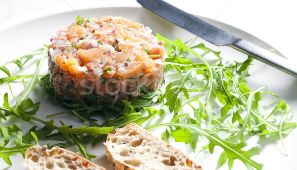 salmon tartare with ruccola Stock photo © phbcz