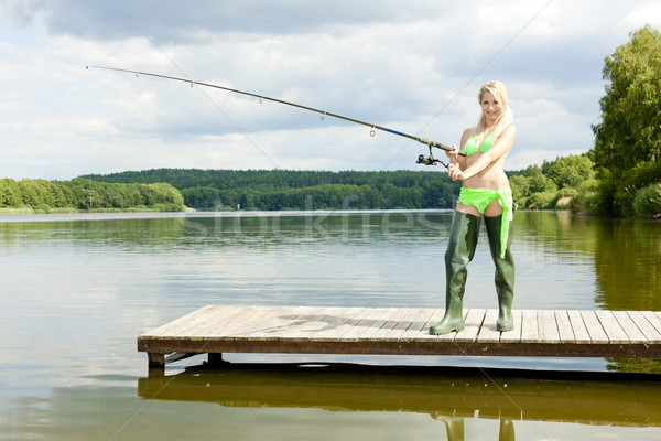 fishing woman standing on pier Stock photo © phbcz