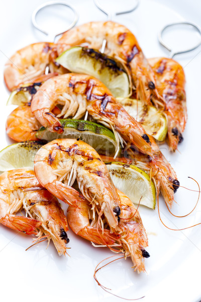 grilled skewers of prawns and lime in honey sauce Stock photo © phbcz