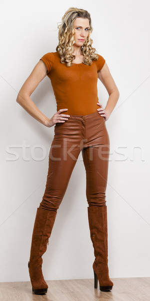 standing woman wearing fashionable brown clothes and boots Stock photo © phbcz