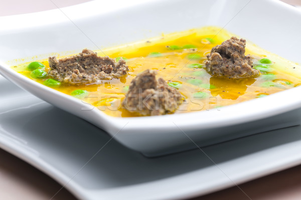 homemade liver dumplings in chicken soup with carrots and peas Stock photo © phbcz