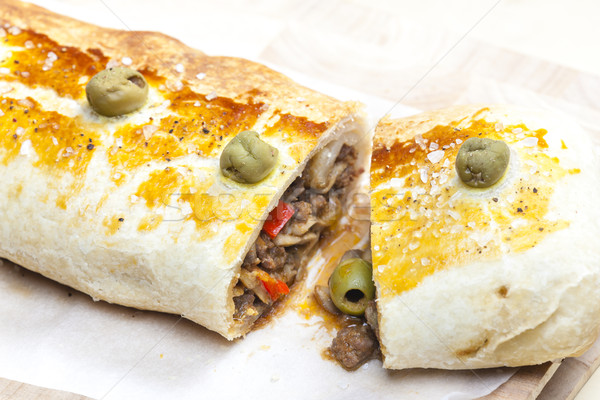 Stock photo: puff roly-poly filled with minced meat and green olives