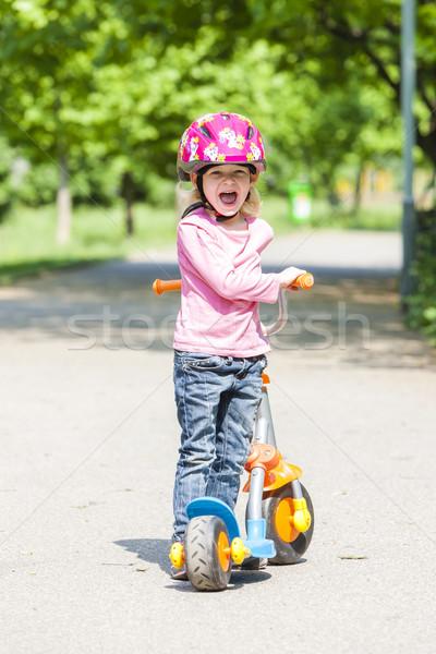 Kislány moped lány gyermek pihen póló Stock fotó © phbcz