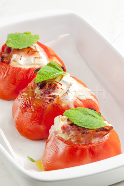 baked tomatoes with goat cheese and pancetta Stock photo © phbcz