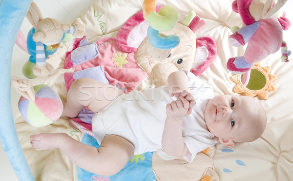 baby girl lying down on playing mat Stock photo © phbcz