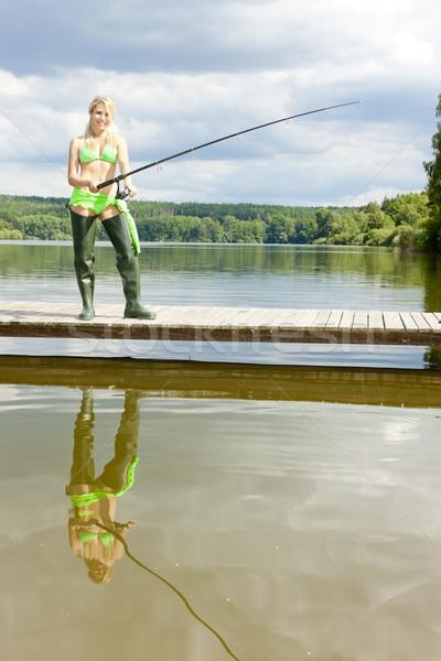 Zdjęcia stock: Połowów · kobieta · stałego · molo · kobiet · kobiet
