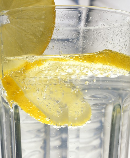 lemon in the glass of water Stock photo © phbcz