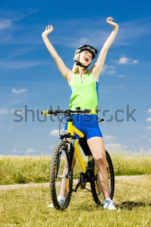 biker with bottle of water Stock photo © phbcz