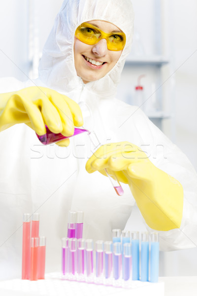 young woman wearing protective coat in laboratory Stock photo © phbcz