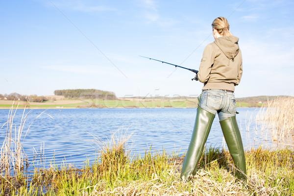 Donna pesca stagno sola femminile stivali Foto d'archivio © phbcz