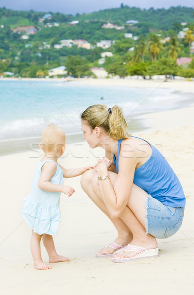 woman with toddler on the beach, Grand Anse Bay, Grenada Stock photo © phbcz
