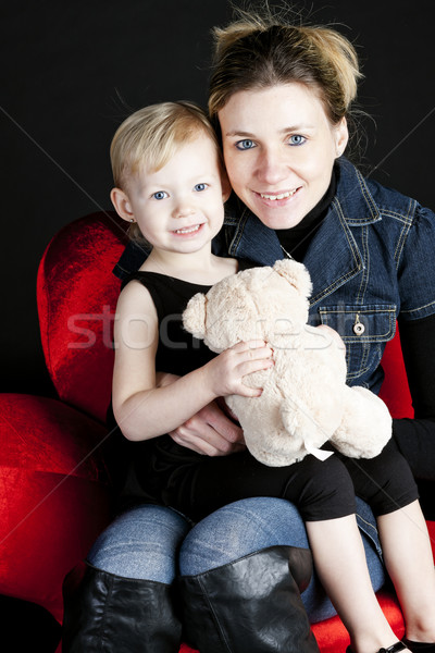 portrait of mother with her little daughter holding teddy bear Stock photo © phbcz