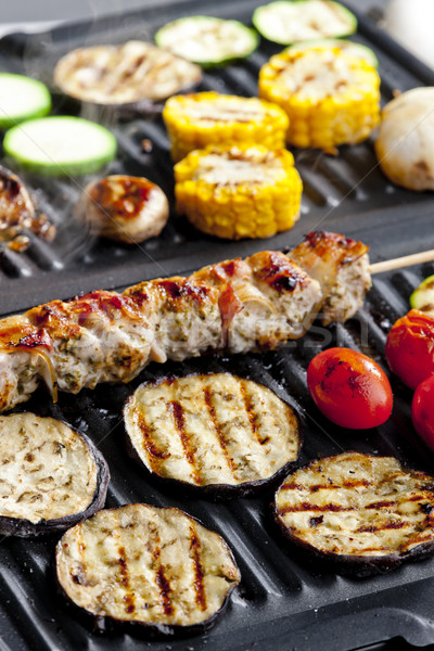 meat skewer and vegetables on electric grill Stock photo © phbcz