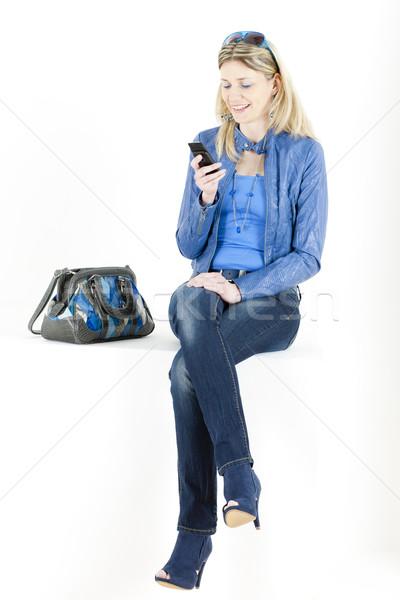 sitting woman with mobile phone and handbag Stock photo © phbcz