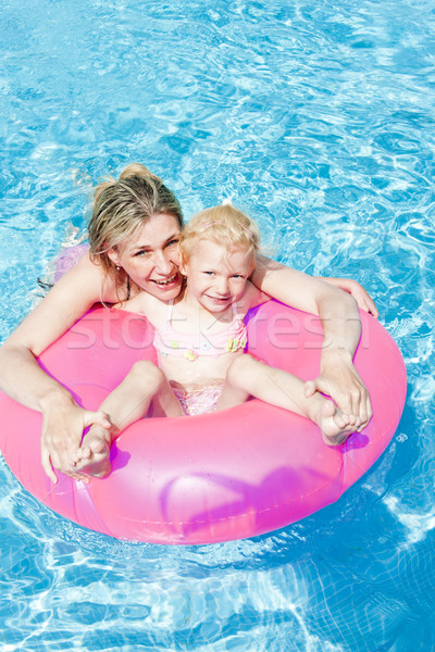 mother with her daughter in swimming pool Stock photo © phbcz