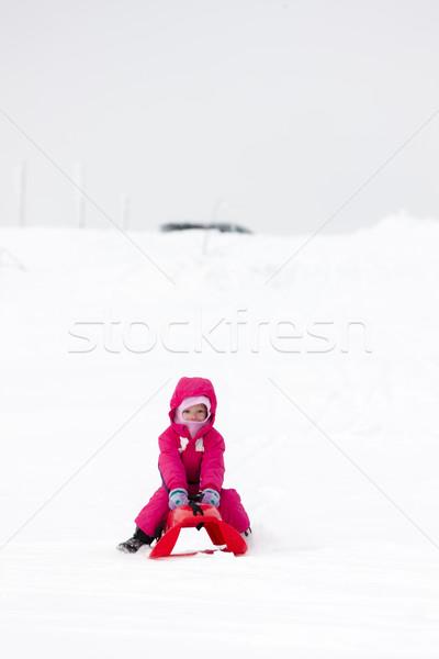 sledding little girl Stock photo © phbcz