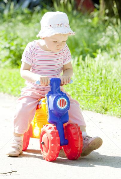 девочку игрушку мотоцикл девушки дети ребенка Сток-фото © phbcz