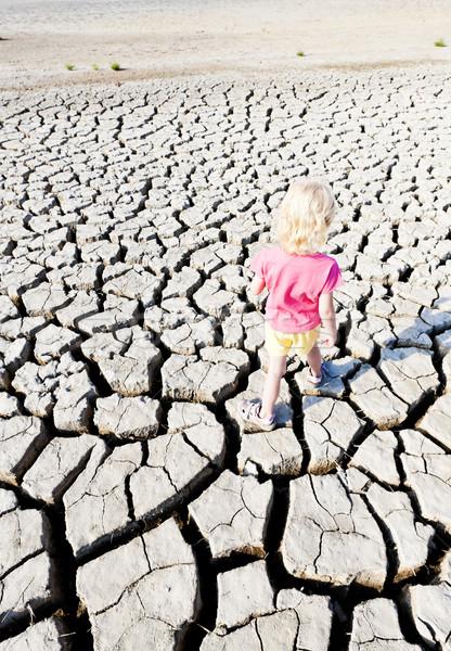 little girl standing on dry land, Parc Regional de Camargue, Pro Stock photo © phbcz