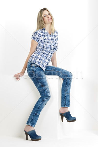 sitting woman wearing jeans and denim clogs Stock photo © phbcz