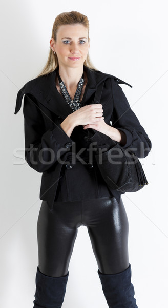portrait of standing woman wearing black clothes with a handbag Stock photo © phbcz