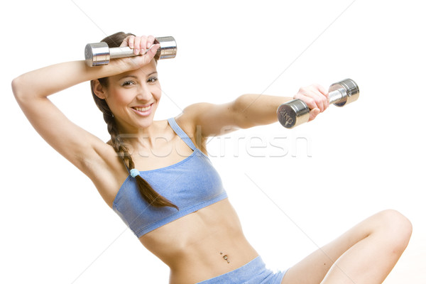 portrait of woman with dumb bells, Stock photo © phbcz