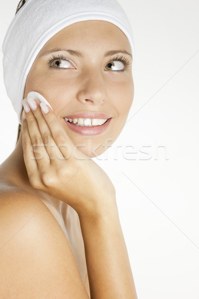 portrait of young woman wearing head dress with cotton pad Stock photo © phbcz
