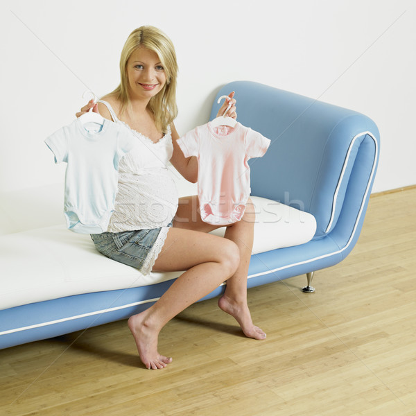 pregnat woman with clothes for babies Stock photo © phbcz