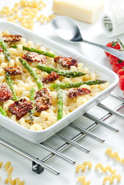 pasta baked with dried tomatoes, asparagus and pecorino cheese Stock photo © phbcz