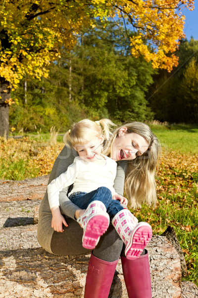 mother with her little daughter in autumnal nature Stock photo © phbcz