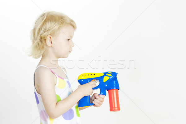portrait of little girl with bubbles maker Stock photo © phbcz
