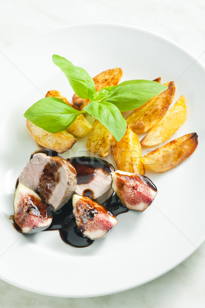 pork tenderloin with figs and sauce of balsamico vinegar Stock photo © phbcz
