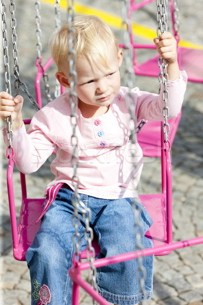 Little girl carrossel menina criança jeans jogar Foto stock © phbcz