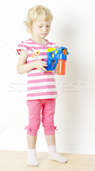 little girl with bubbles maker Stock photo © phbcz