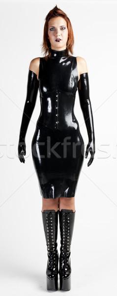 Em pé mulher látex roupa mulheres Foto stock © phbcz