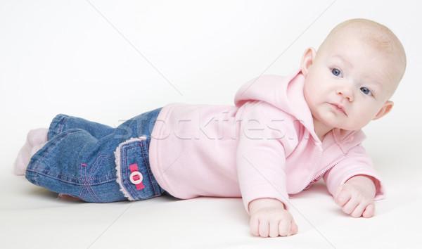 lying down baby girl Stock photo © phbcz