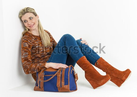 sitting woman wearing fashionable platform brown shoes with a ha Stock photo © phbcz