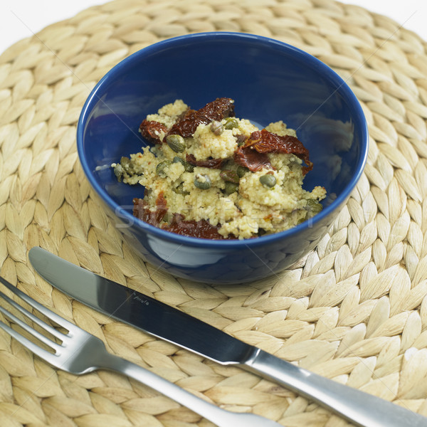 warm couscous salad with dried tomatoes and capers Stock photo © phbcz