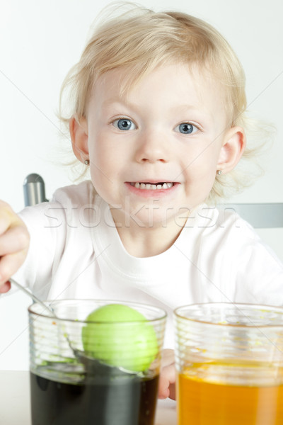 little girl during Easter eggs'' coloration Stock photo © phbcz