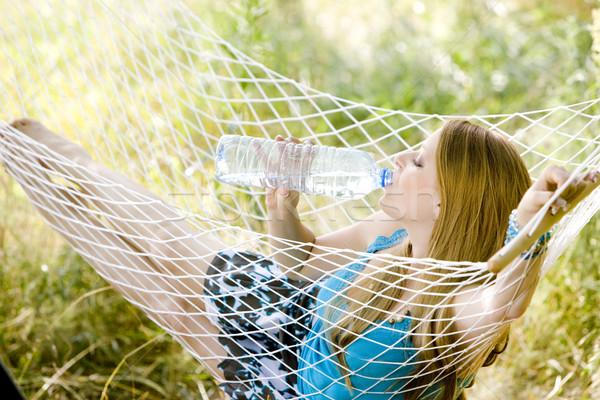 Nő pihen függőágy víz fiatal egyedül Stock fotó © phbcz