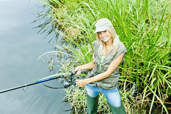 Nő halászat tavacska sport női mosolyog Stock fotó © phbcz