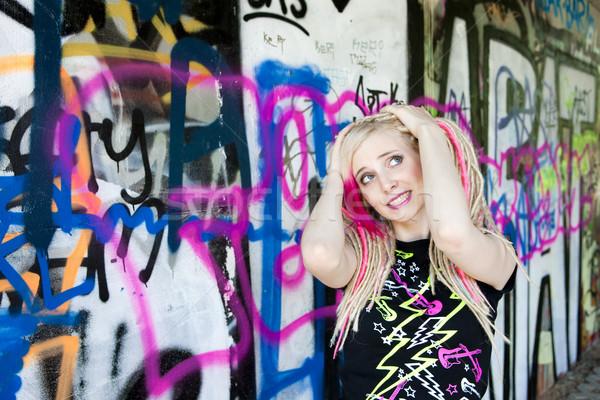 portrait of young woman at graffitti wall Stock photo © phbcz